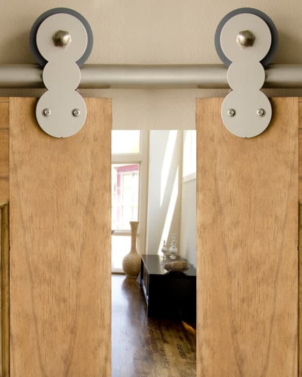 definitely-a-design-statement-but-is-an-interior-barn-door-right-for-your-home