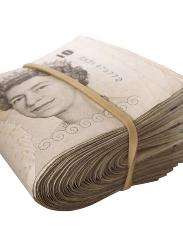 Roll of British Pound banknotes