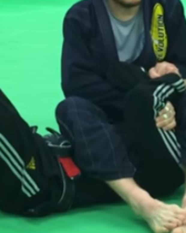 how-to-finish-an-armbar-when-they-grab-their-arms-bjj