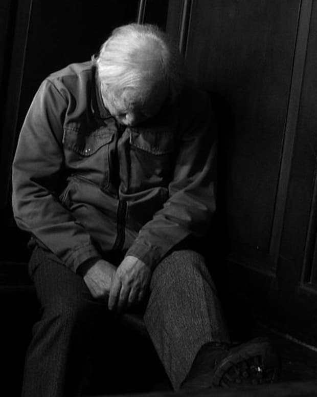 one-old-man-bowed-in-church