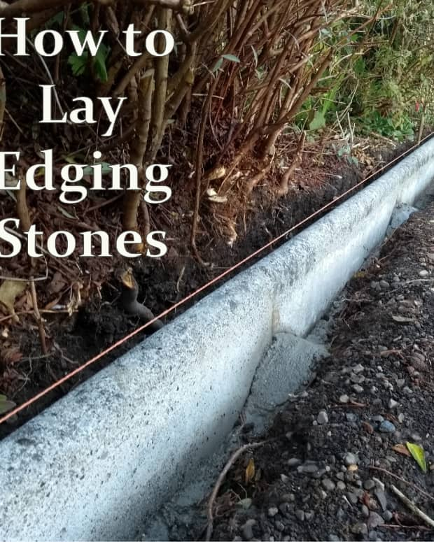 laying-concrete-edging-stones-along-a-driveway