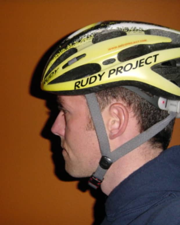 This is a proper fitting helmet. The forehead is not exposed and the straps are relatively tight.
