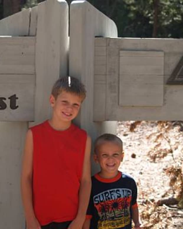 Two of my boys at the entrance to the Lava Cast Forest park