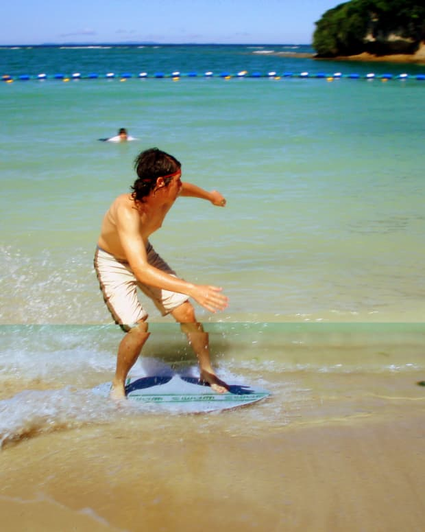Beach skimboarding in Okinawa Japan