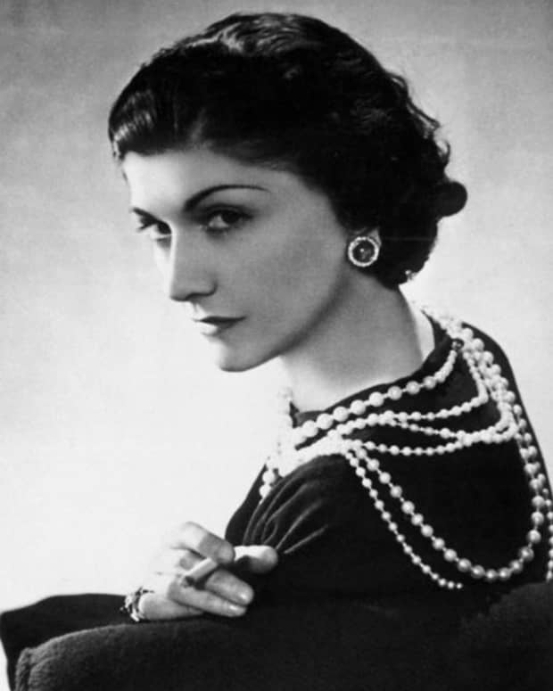 Coco Chanel popularized wearing a little black dress with layered pearl necklaces