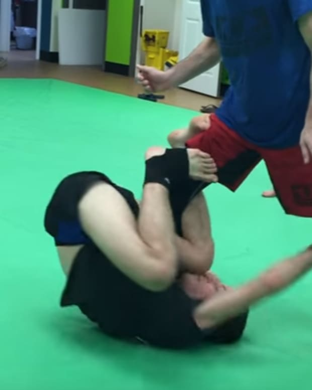 reverse-de-la-riva-guard-taking-the-back-tutorial