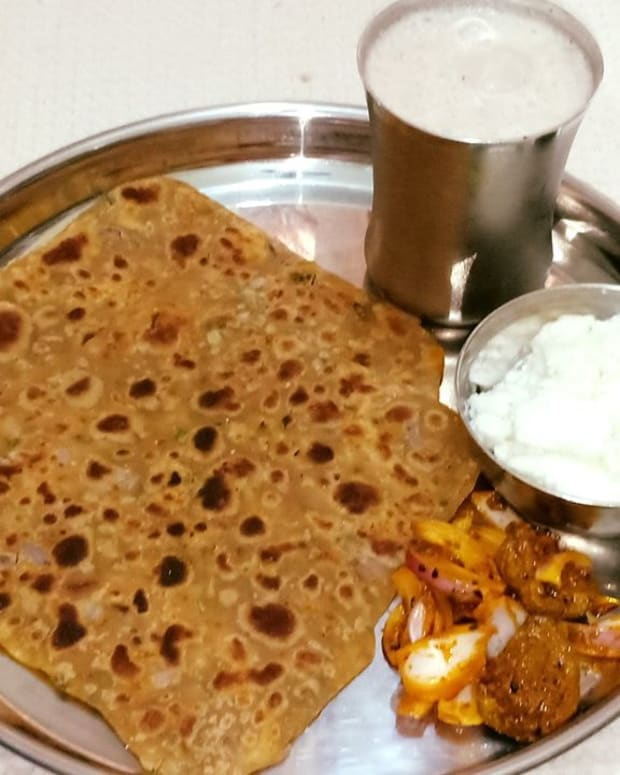 missi-rotibesan-paratha-with-homemade-butter-and-chaach-a-traditional-punjabi-meal