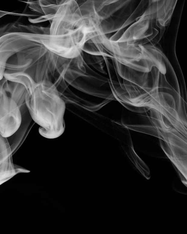 the-passenger-ashes-his-cigarette