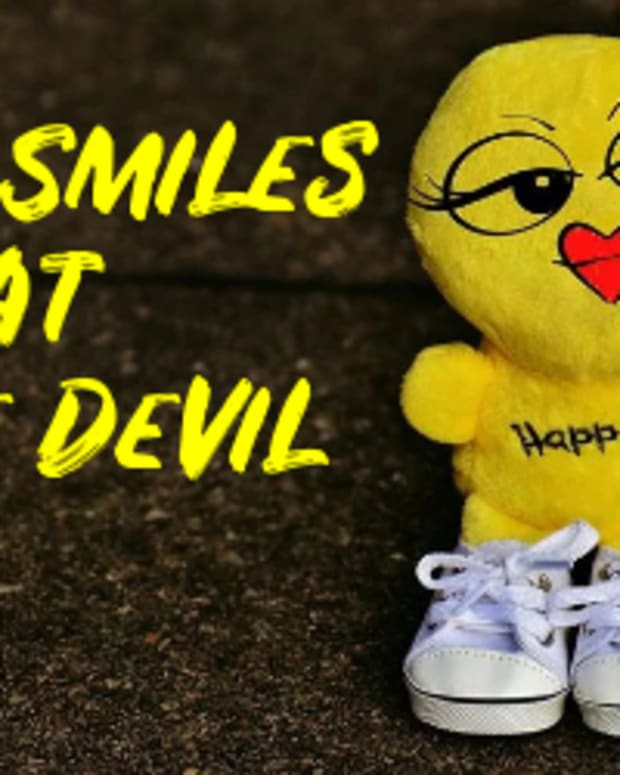 poem-she-smiles-at-the-devil