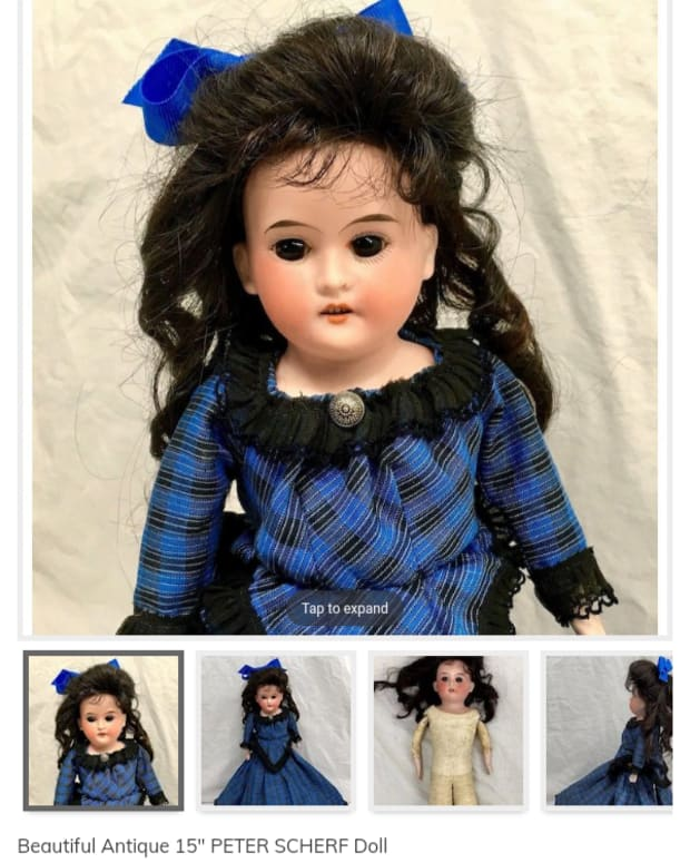 Scherf antique doll, blue dress black hair.