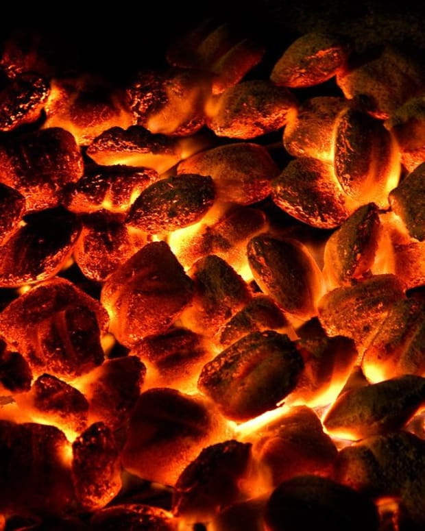 a-person-with-a-coal-of-fire-does-not-play-by-river-bank-1