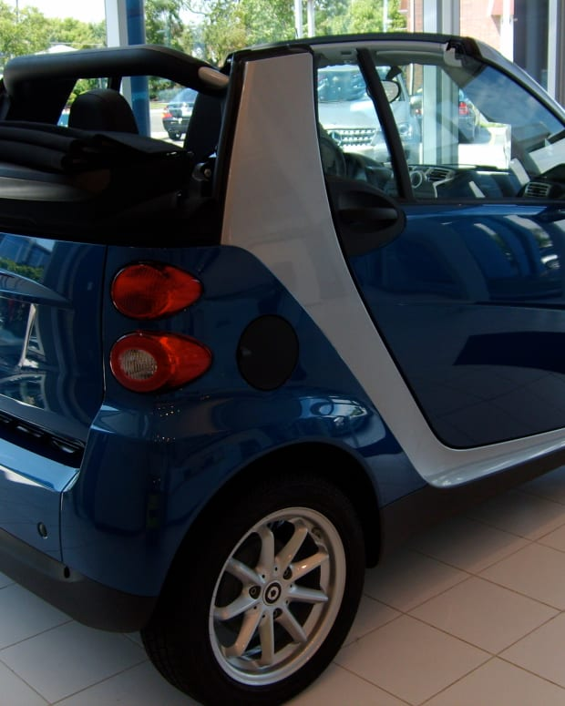 Dealer's blue Smart Car Side View