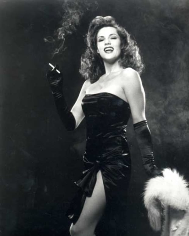 Rita Hayworth - But Femme Fatales Don't Normally Smile!