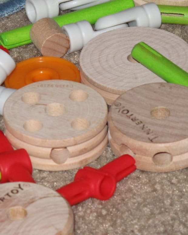 The new Tinker Toys come with classic wooden shapes and connectors, but add several fun new pieces as well, including wheels and hinges.