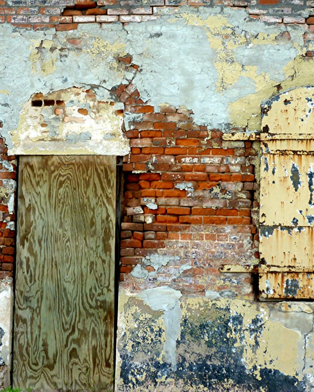 Colorful effects of an exterior old brick and plastered wall in Calvert, Texas * Photo by Peggy W
