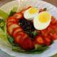 Boiled egg, strawberries, black beans, tomatoes, spinach and Iceberg lettuce