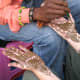 henna or mehdi being applied on the hands