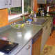 Ugly Formica countertops and faux-finished laminate cabinets.