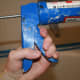 Squeeze the trigger once or twice to get the caulk tube to stay put.
