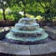The large, formal fountain is the focal point of the test garden's central plaza.