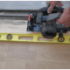 Use a circular saw to remove hardwood or laminate flooring.