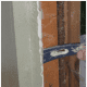 Use a pry bar to remove drywall.