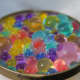 Kids can sort different shapes and colors of water beads.