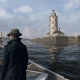 """The Harbor Lighthouse in game. You can see the """"Mad Mile"""" to the left and sort of the illusion of a rip-rap on the left side of the island. In case you're wondering YES you can get stuck in a glitch trying to climb them sometimes . . ."""