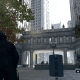 The Crowley Building courtyard. Notice how Ubisoft added in a bunch of brush (and there's like a car dealership behind where Aiden's facing). In real life it's just a very wide expanse of cement. Nothing wrong with that though!