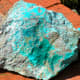 Fake turquoise is not valuable, but it's pretty! Found near a small abandoned turquoise mine near Yuma, Arizona.