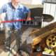 Shoveling gold bearing? dirt into the hopper.