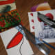 Before you start, assemble everything that you need: postcards, ruler, pencil, craft knife . . .