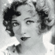 Marion Davies with a chin length curly bob.