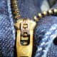 Adriano Goldschmied AG logo stamped on zipper slider