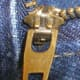 Close up of a genuine YKK zipper fastener. The YKK lettering could appear on both front & rear of the slider hardware