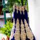 A-cut navy blue wedding lehenga with heavy zardozi work.