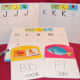 Lakeshore Learning Uppercase and Lowercase writing books; wipe-off alphabet cards from Ross