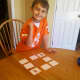 My son making a match in coin memory!