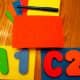 Use stencils to draw the letters and numbers.