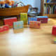 Recycle old boxes to create a pretend town for children.