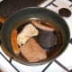 The Lorne sausage and black pudding are added to the pan after the pork has been turned