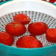 Drop the blanched tomatoes in ice-water.