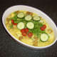 Cucumber, tomatoes and coriander/cilantro are added to the casserole