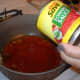 Add the tomato sauce to the oil.