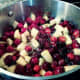 The cranberry-apple mixture is beginning to boil.