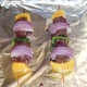 Kangaroo skewers are grilled on foil covered tray