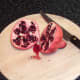 Pomegranate is cut in half to expose seeds