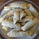 Homemade nut rolls on a plate.