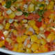 Step six: Garnish with roasted halved peanuts. Corn chaat is ready!
