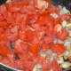 Step four: Add chopped tomatoes. Stir-cook over medium-high fire until they become mushy. Cover the pan for 2-3 minutes for fast cooking.